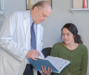 Dr-Drossman-Discussing-a-File-with-Gabrielle-Gallien